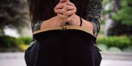 praying hands and bible