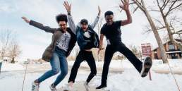 3 people jumping for joy